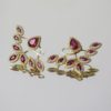 Glass filledrugby and diamond earrings